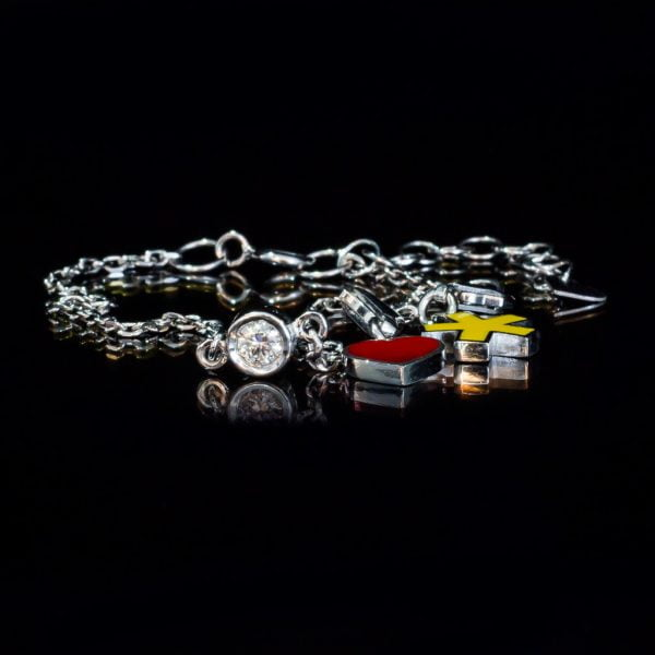 white gold iamchange bracelet with diamond and charms
